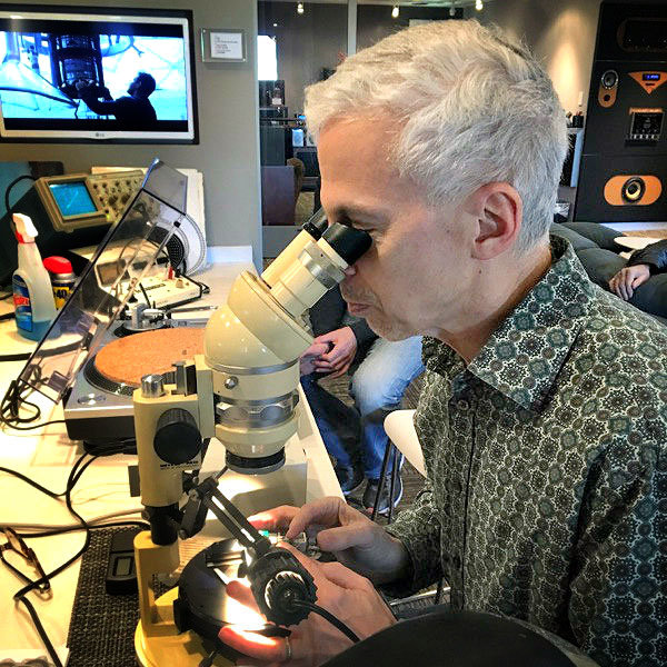 Ken diagnosing an issue with a microscope