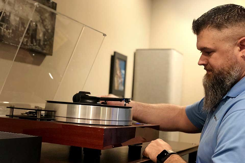 Adam sets a turntable