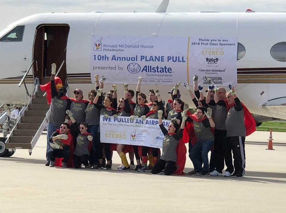 The team in front of the plane they pulled