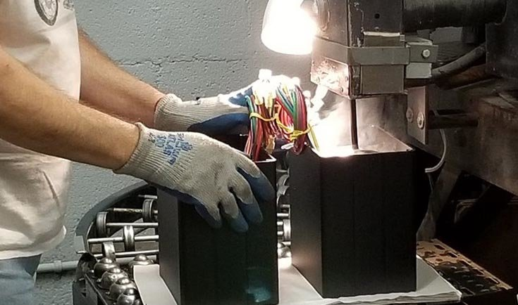 Hot liquid tar is poured into a brand new Autoformer to hold everything in place