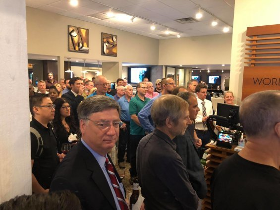 Photo of attendees in the showroom