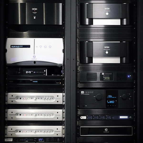 This is the rack of JBL Synthesis, Mark Levinson, JL Audio, and Kaleidescape electronics that home theater dreams are made of.
