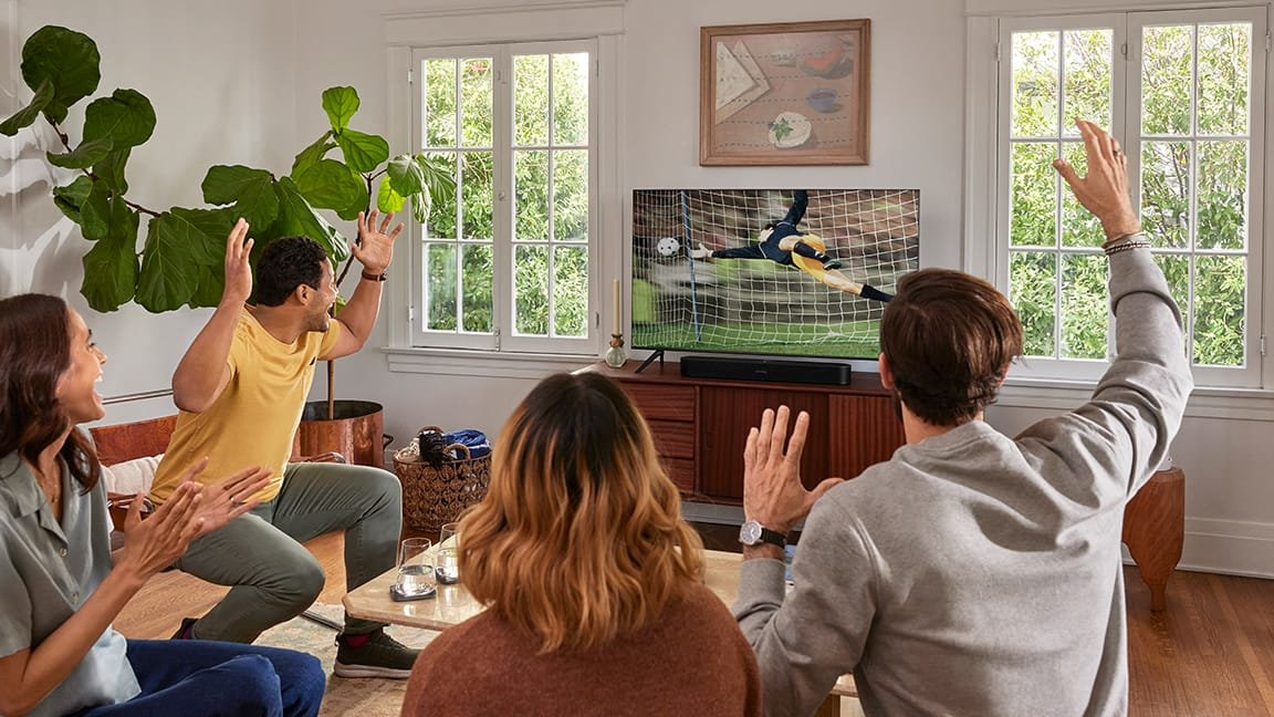 People watching soccer game on TV with Sonos Beam Gen 2 sound bar