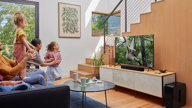 Family watching TV with Sonos Beam Gen 2