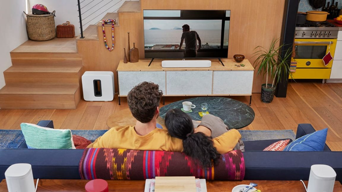 Couple watching movie with Sonos Beam Gen 2 and Sub Gen 3